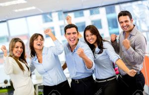 18096732-Successful-business-group-with-arms-up-at-the-office-Stock-Photo